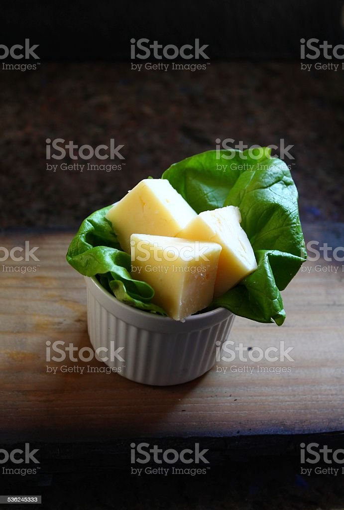 Prepared Cheese triangles on a bed of lettuce stock photo