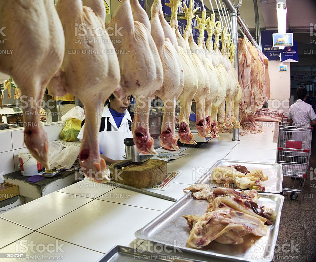 Prepared chickens hanging up in Lima street market royalty-free stock photo