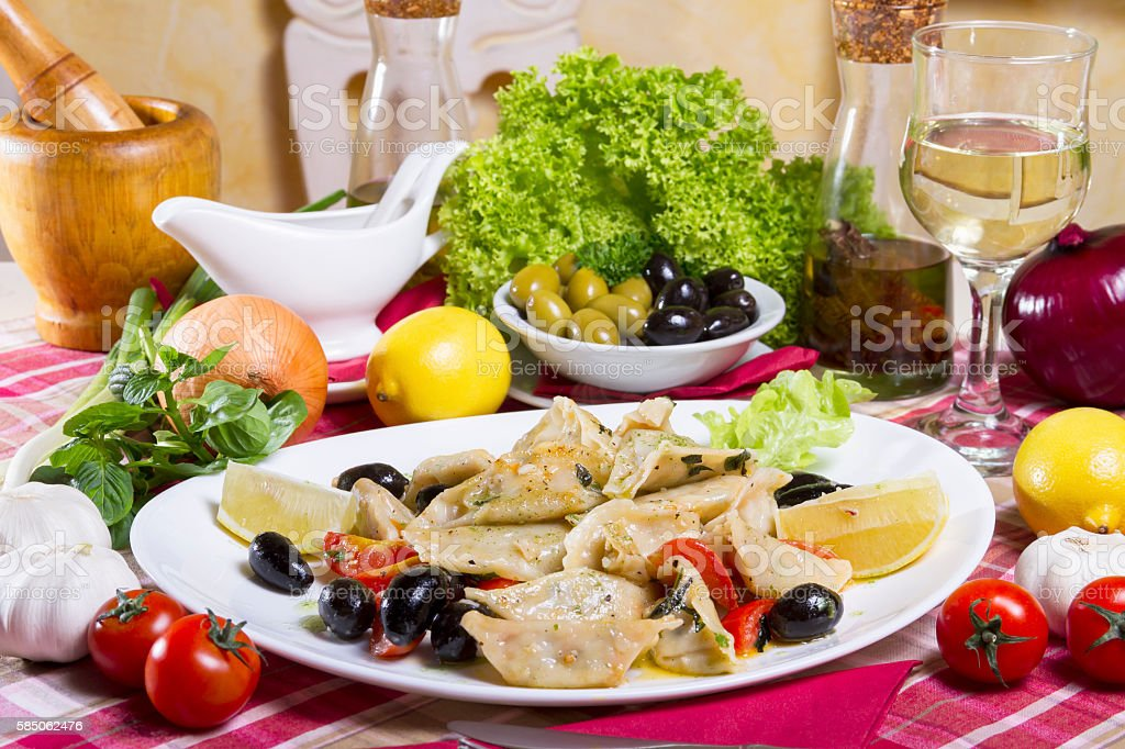 Prepared Cod Pieces Vegetables and a Glass of White Wine stock photo
