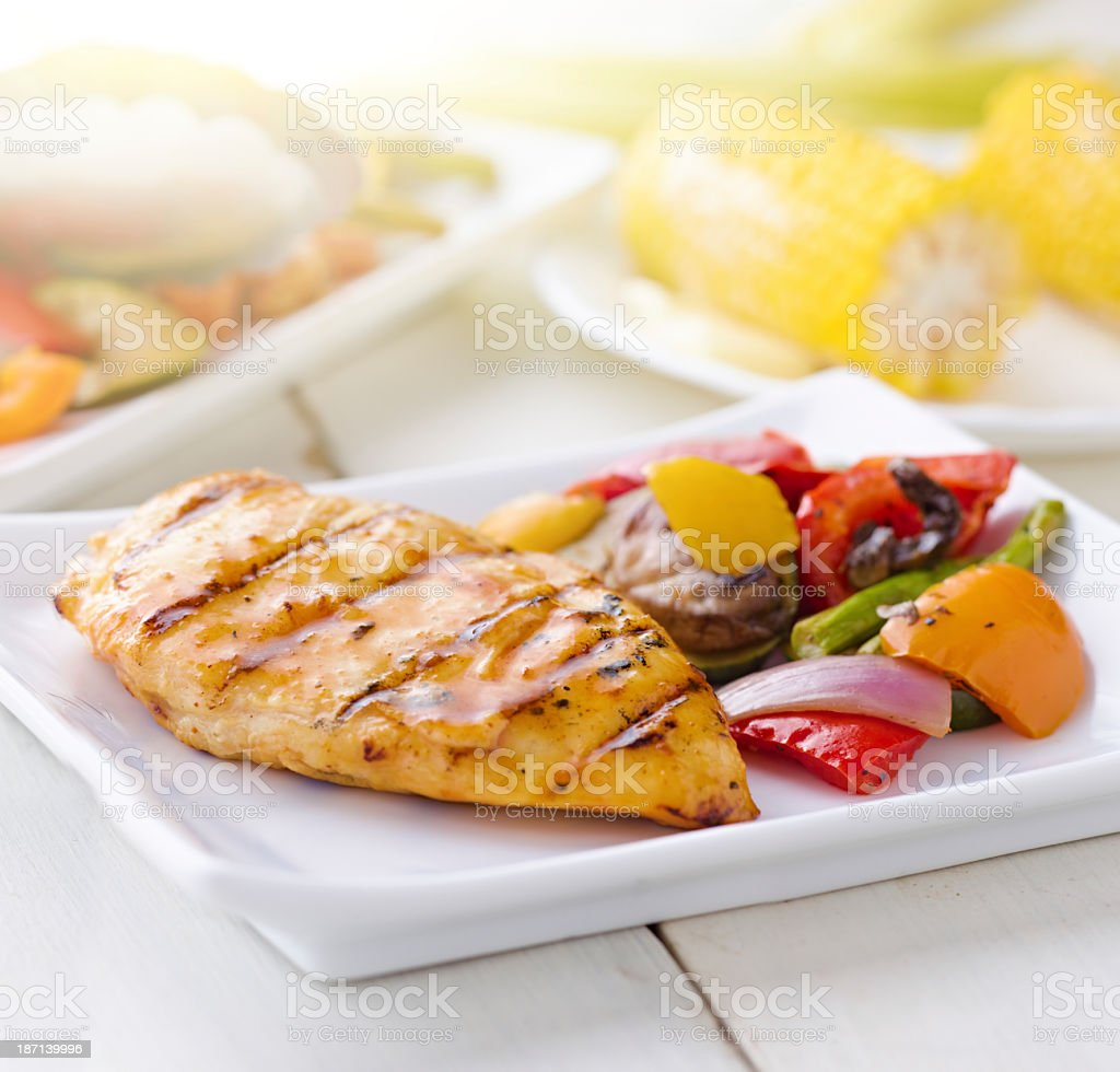 Prepared dinner of chicken vegetables and corn on the cob stock photo
