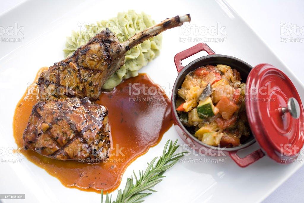 Prepared dinner of rack of lamb with gravy stock photo