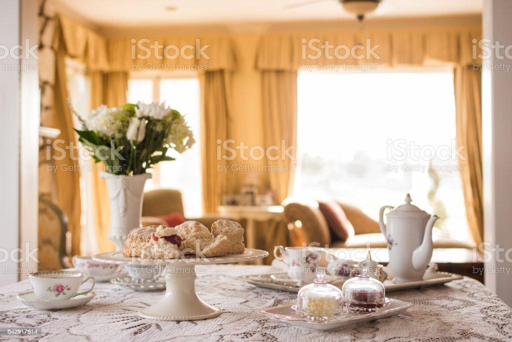Prepared English tea and scones in living room stock photo