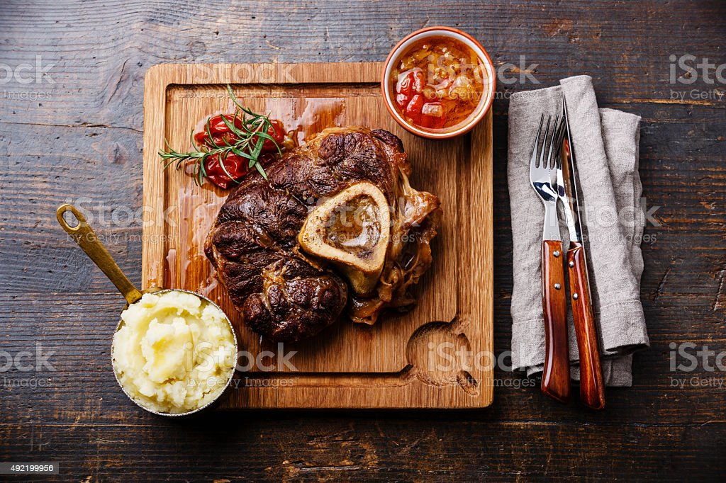 Prepared Osso buco Veal shank and mashed potatoes stock photo