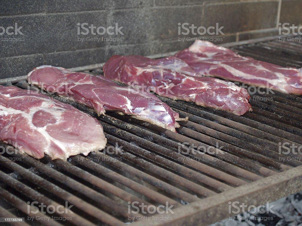 Preparing 4 argentinian steaks royalty-free stock photo