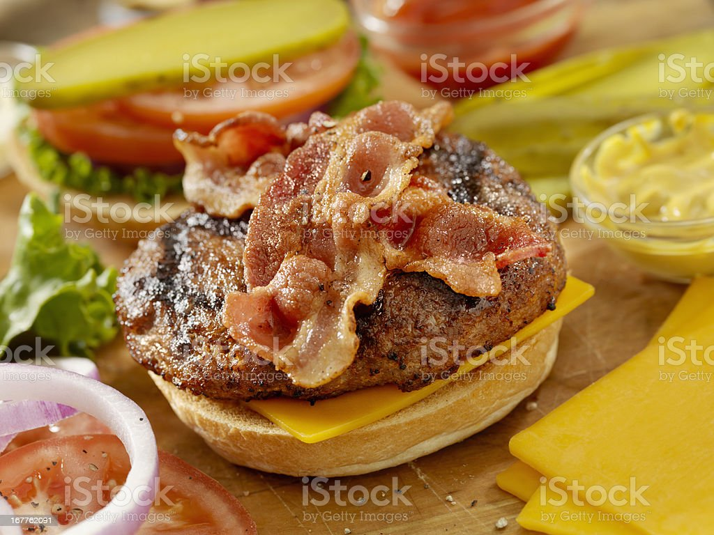 Preparing a Bacon Cheeseburger stock photo