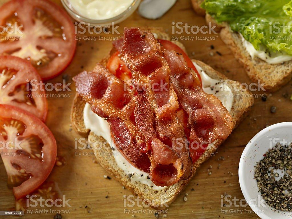 Preparing a BLT Sandwich stock photo