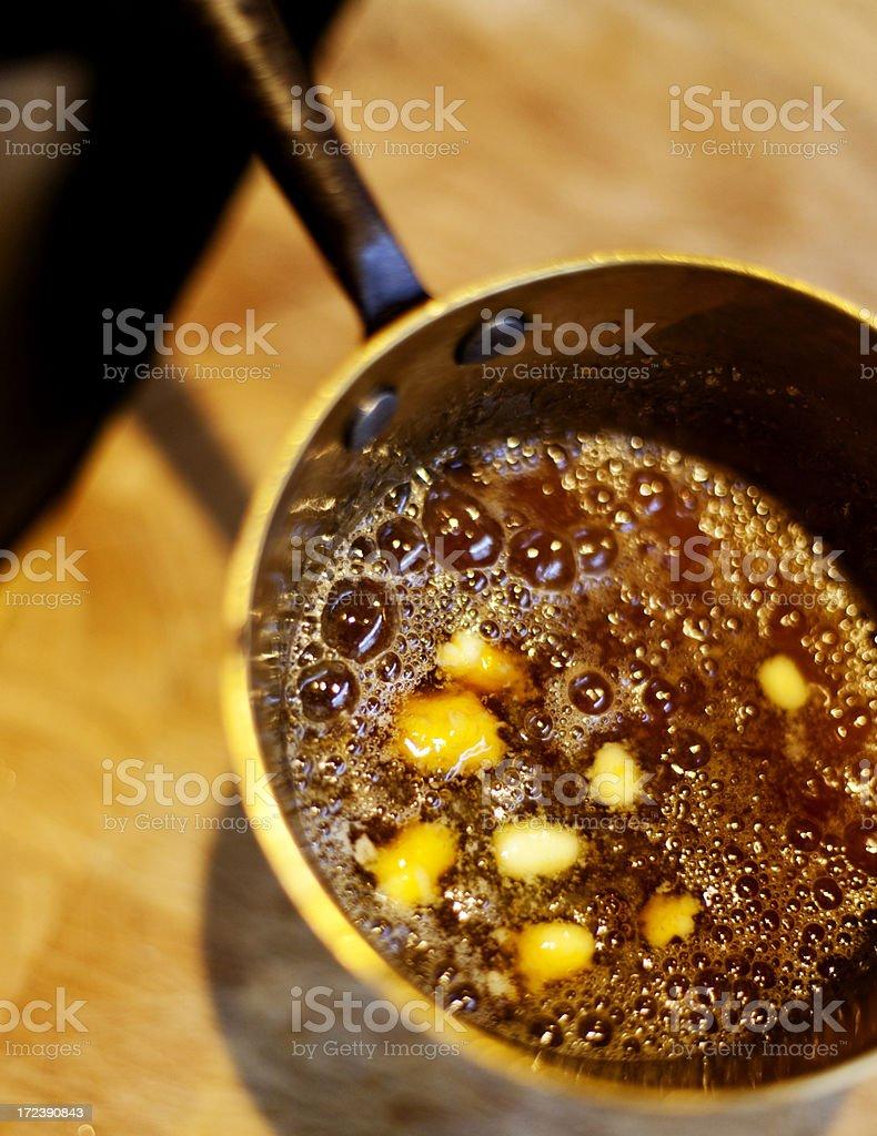 Preparing a caramel sauce stock photo