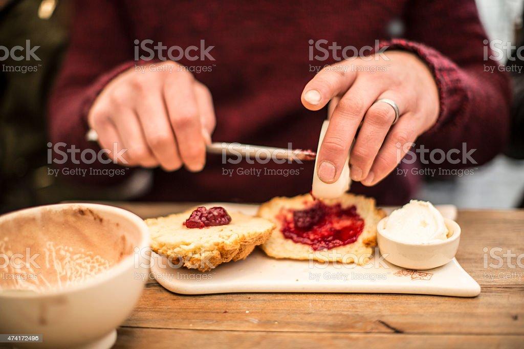 preparing a delicious scone stock photo