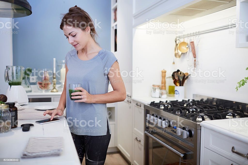 Preparing a green smoothie at home. stock photo