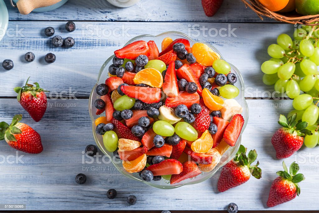 Preparing a healthy spring fruit salad stock photo