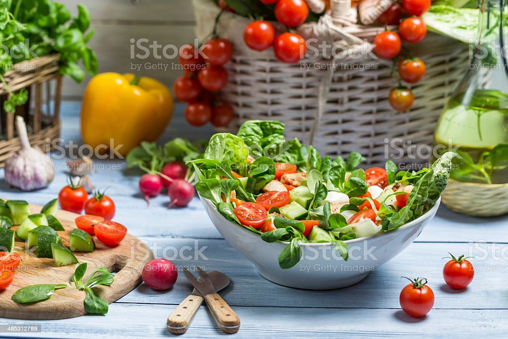 Preparing a healthy spring salad stock photo