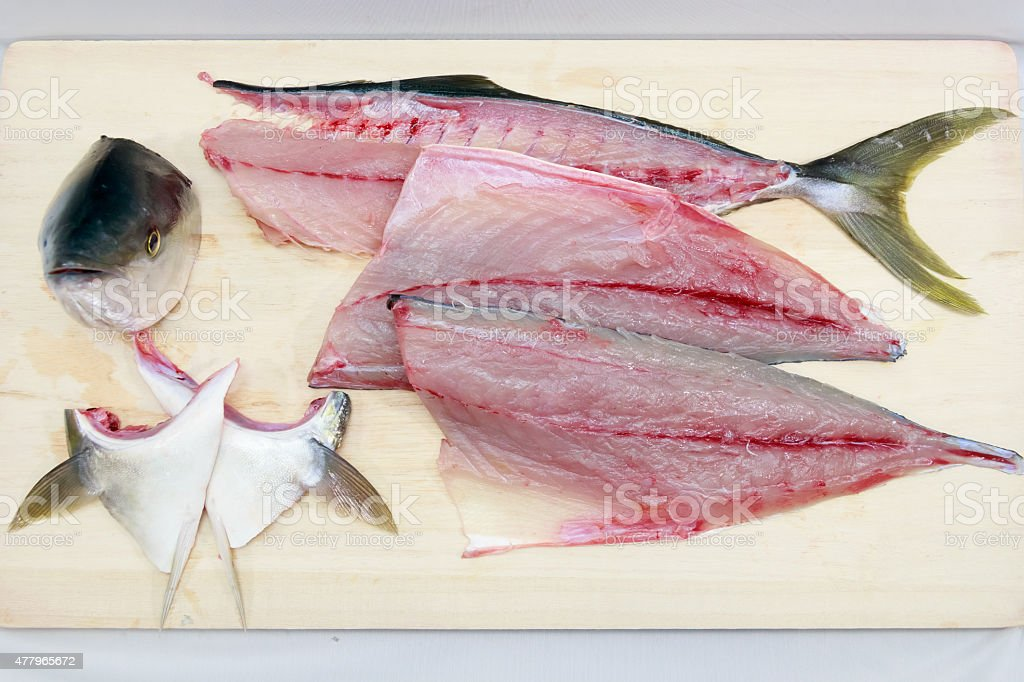 Preparing a Japanese yellowtail in the Japanese style stock photo