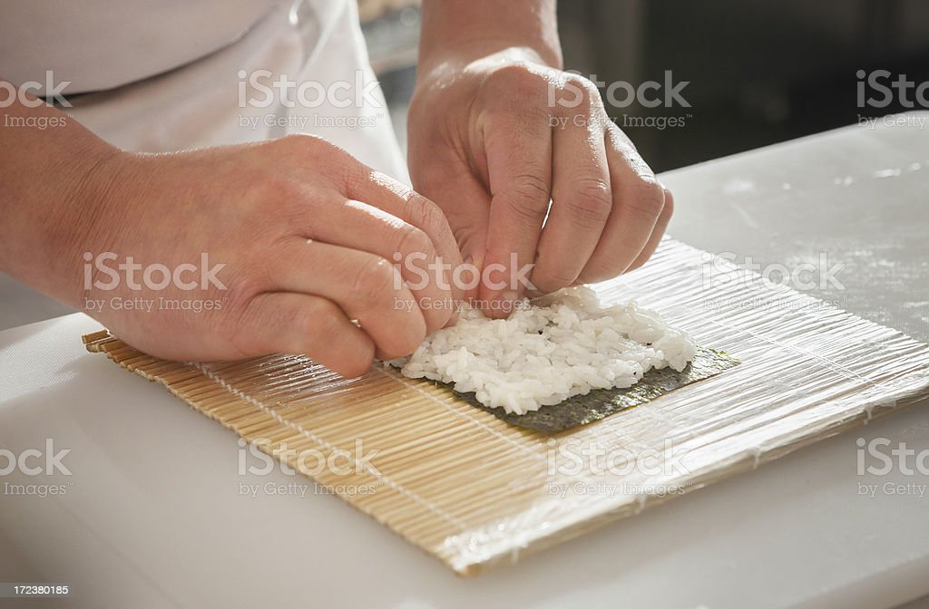 Preparing a Sushi Roll stock photo