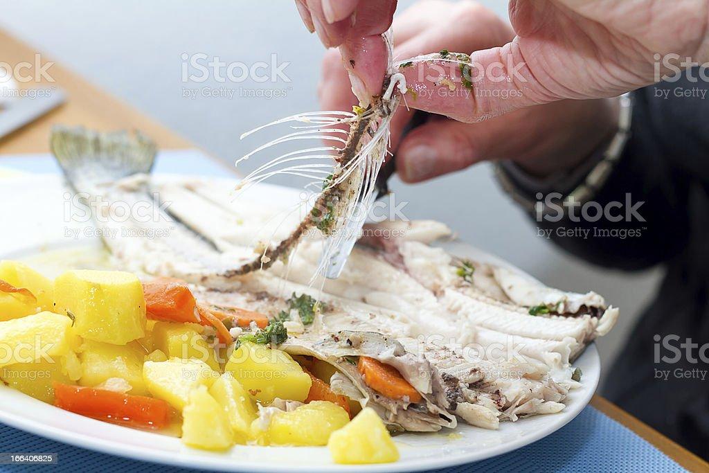 Preparing a trout fish stock photo