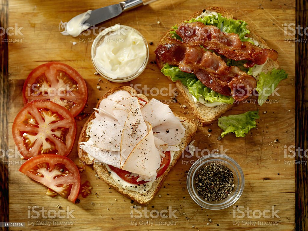 Preparing a Turkey BLT Sandwich royalty-free stock photo