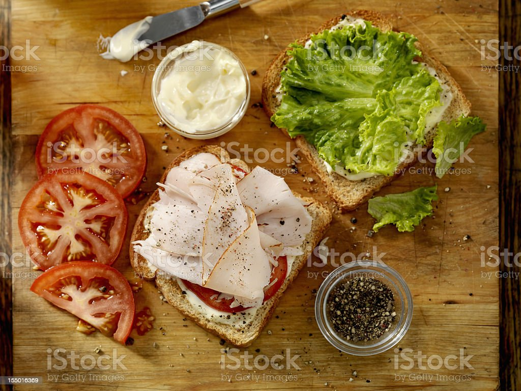 Preparing a Turkey Sandwich stock photo