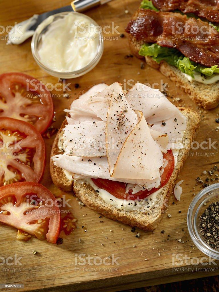 Preparing a Turkey Sandwich royalty-free stock photo
