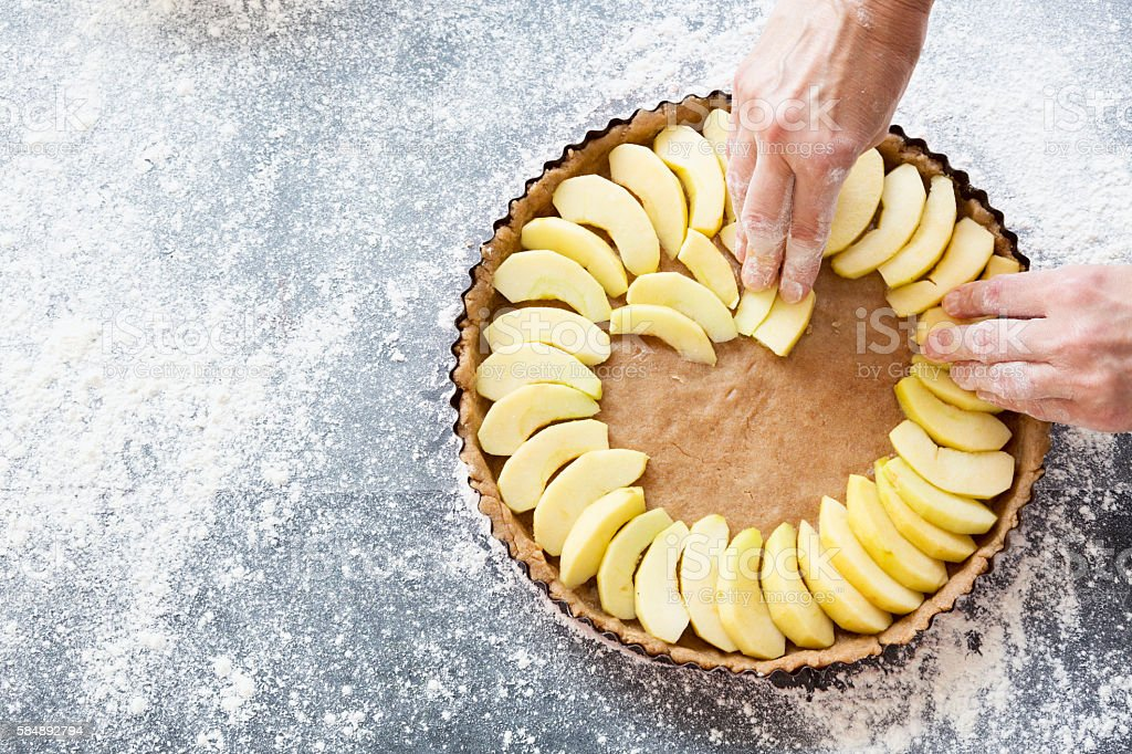 preparing an apple pie stock photo