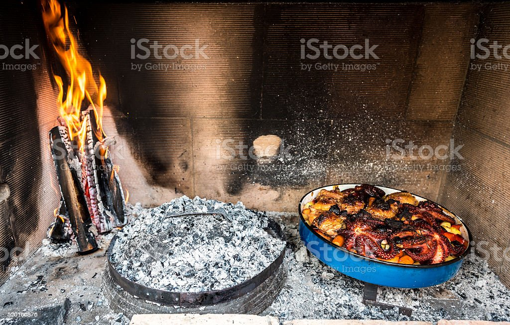 Preparing and Cooking of octopus and chicken in traditional Balk stock photo