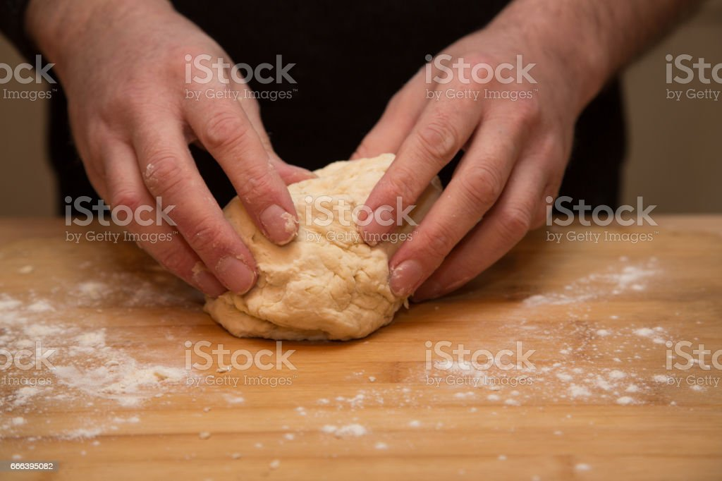Preparing and cooking sausage rolls with butter-rich pastrydients stock photo