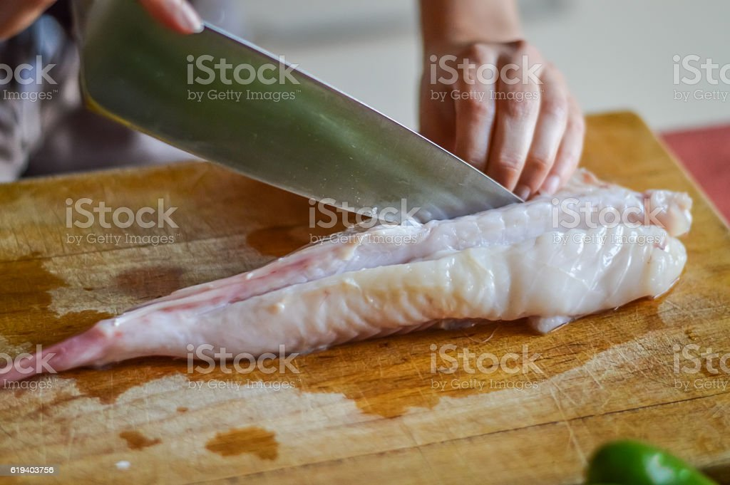 preparing anglerfish before cooking (Lophius piscatorius) stock photo