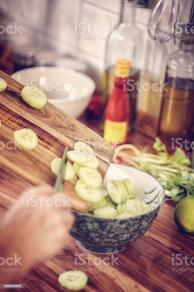 Preparing Asian Pickled Cucumber Salad stock photo