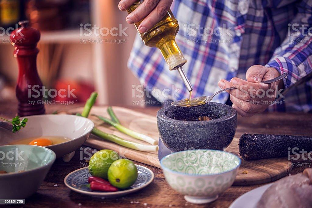 Preparing Asian Soy Sauce Marinade in Pestle and Mortar stock photo