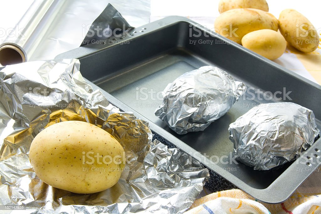 Preparing baked potatoes stock photo