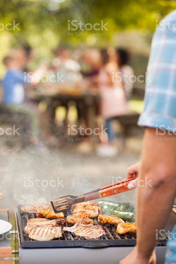 Preparing barbecue meal for family stock photo
