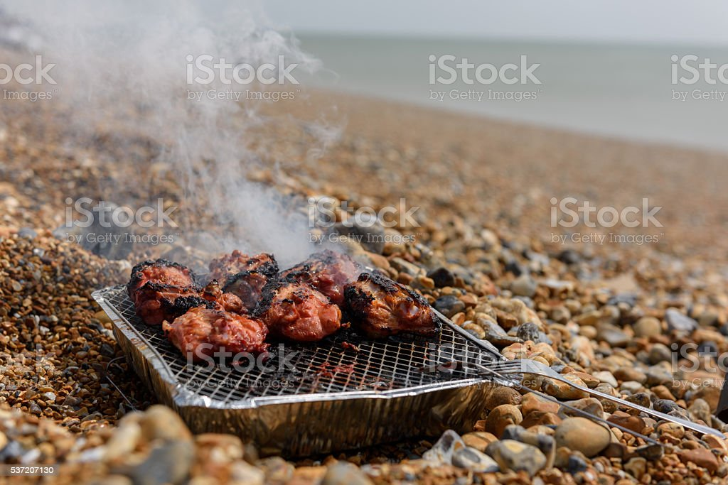 Preparing barbecue on the Beach stock photo