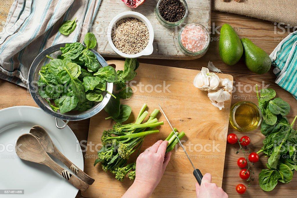 Preparing Brocolli, Spinach Quinoa Salad stock photo