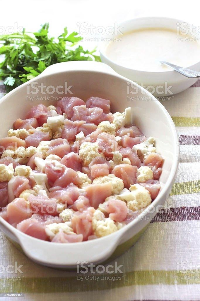 Preparing chicken breast and cauliflower casserole royalty-free stock photo