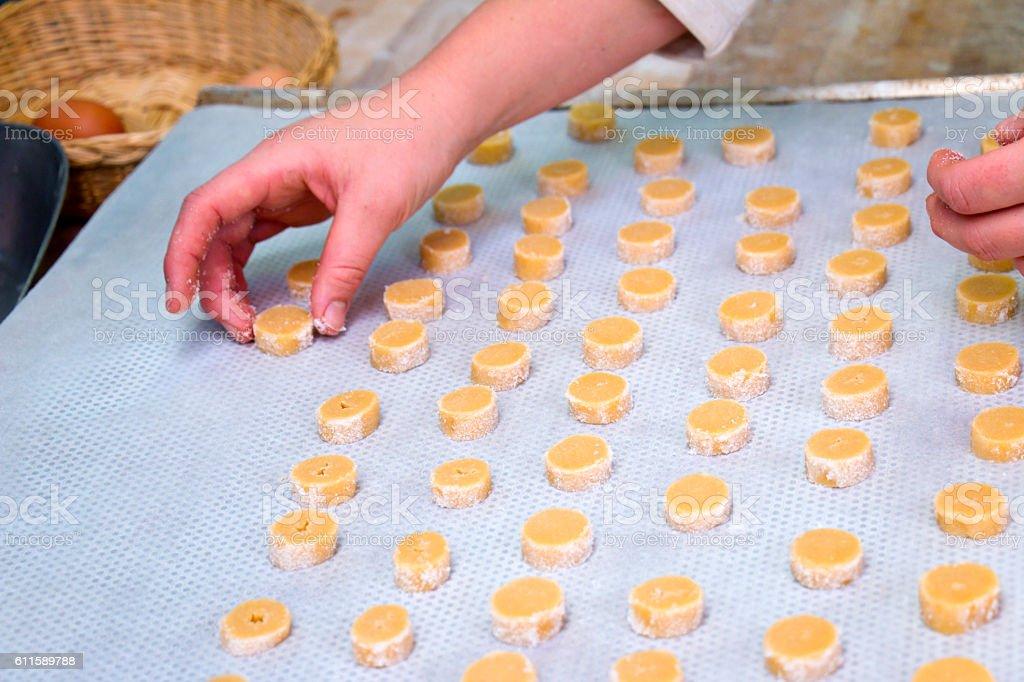 Preparing cookies on a baking sheet stock photo