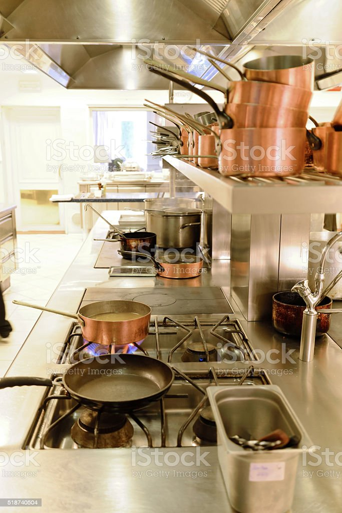 preparing dinner in restaurant kitchen stock photo