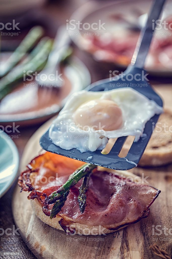 Preparing Egg Benedict For Breakfast stock photo