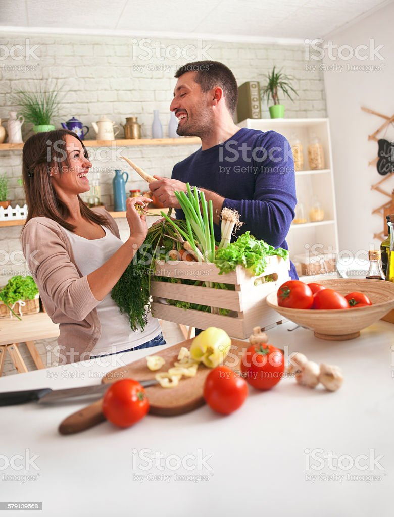 Preparing Family Breakfast In Kitchen stock photo