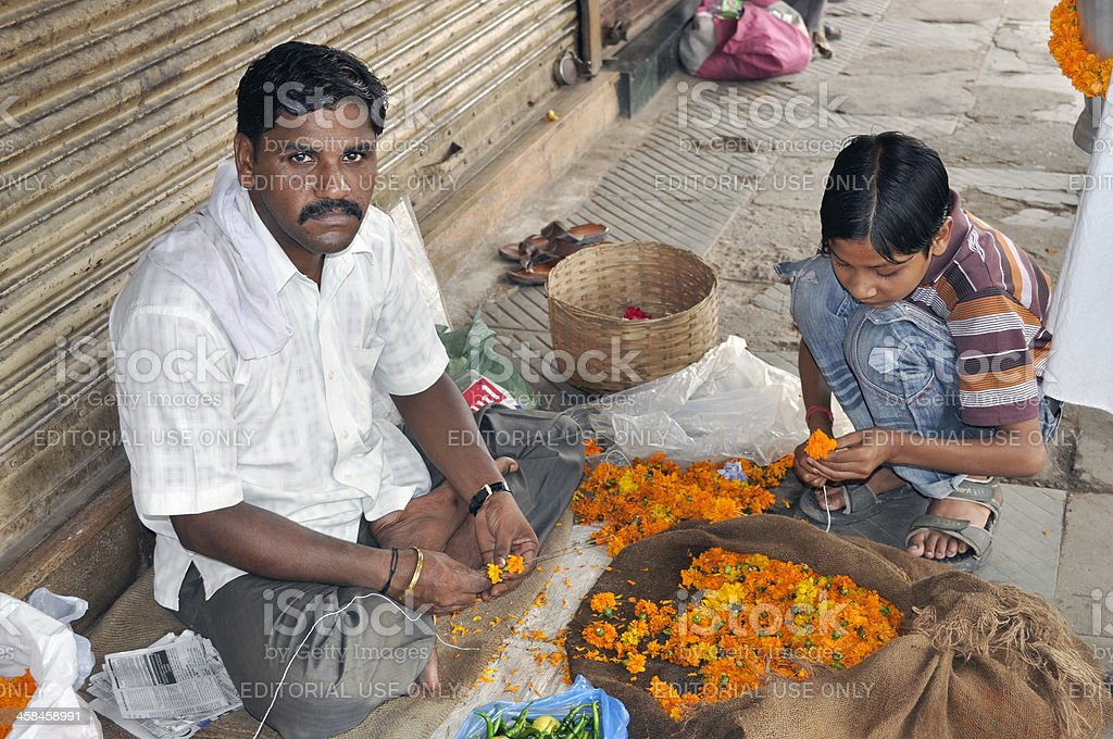Preparing Flower Garlands in Delhi royalty-free stock photo