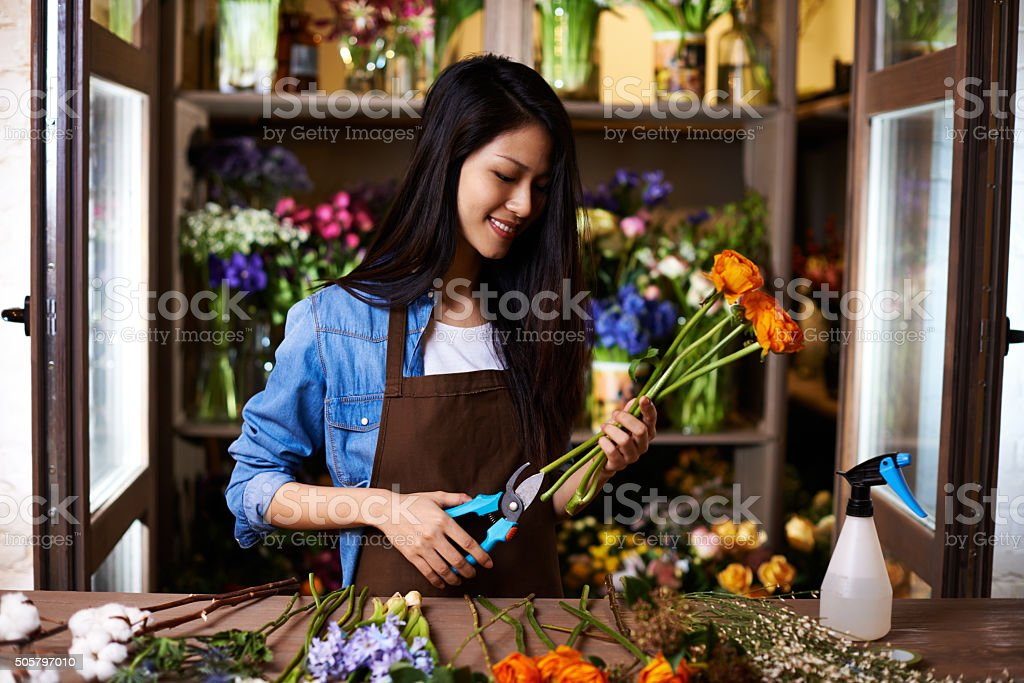 Preparing flowers for arranging stock photo