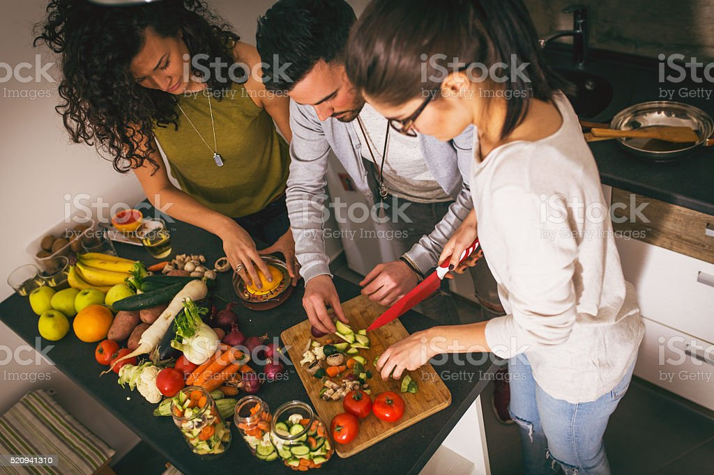 Preparing food at the kitchen stock photo