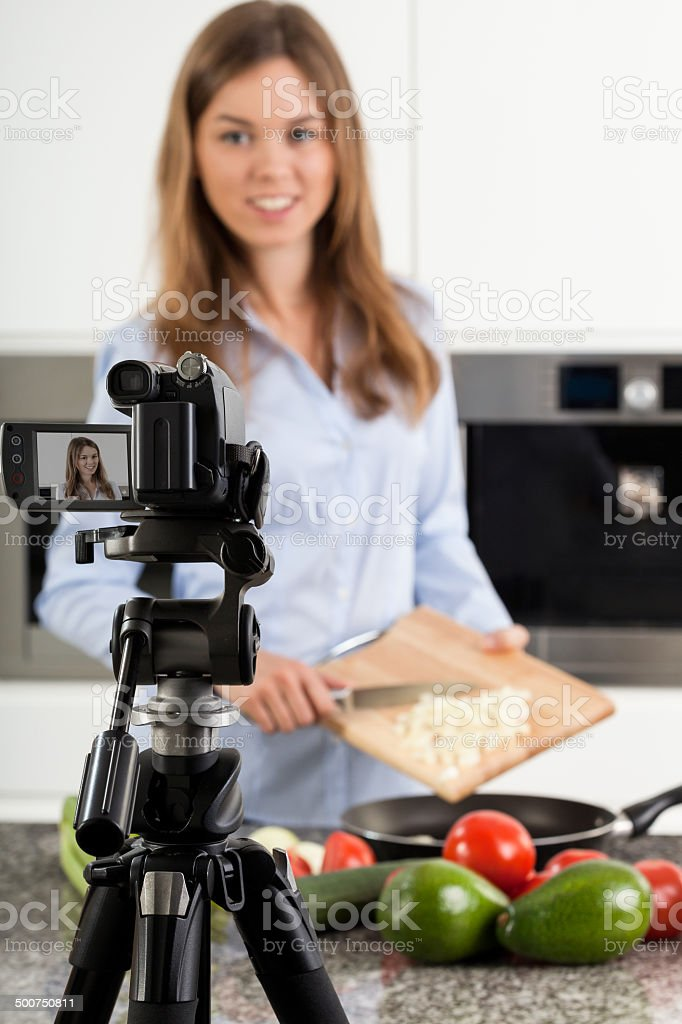 Preparing food during cooking show stock photo