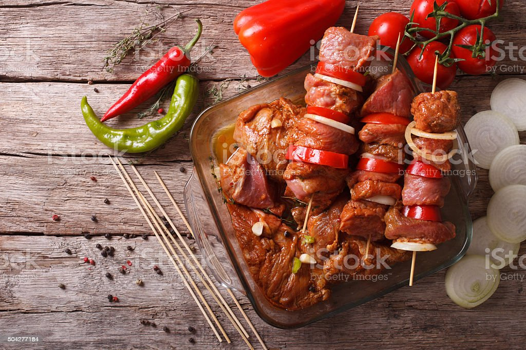 Preparing food for cooking barbecue on skewers. horizontal top v stock photo