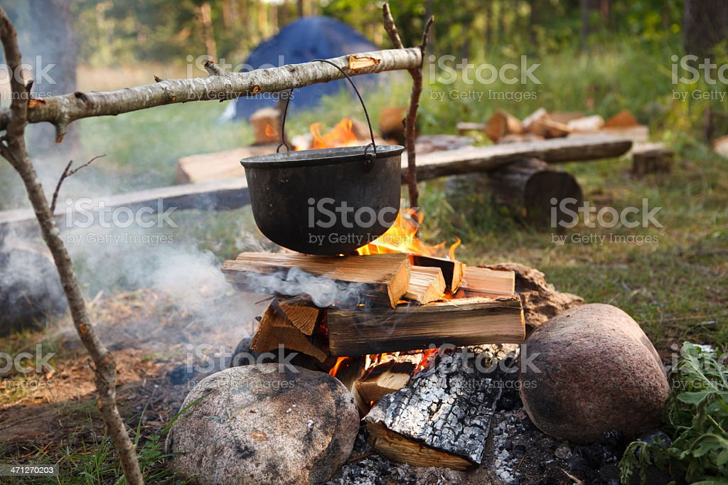 Preparing food on campfire royalty-free stock photo