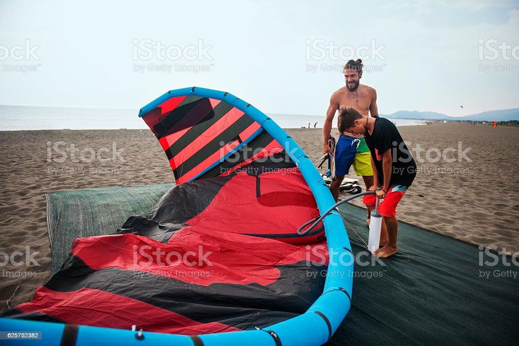 Preparing for kite surfing stock photo