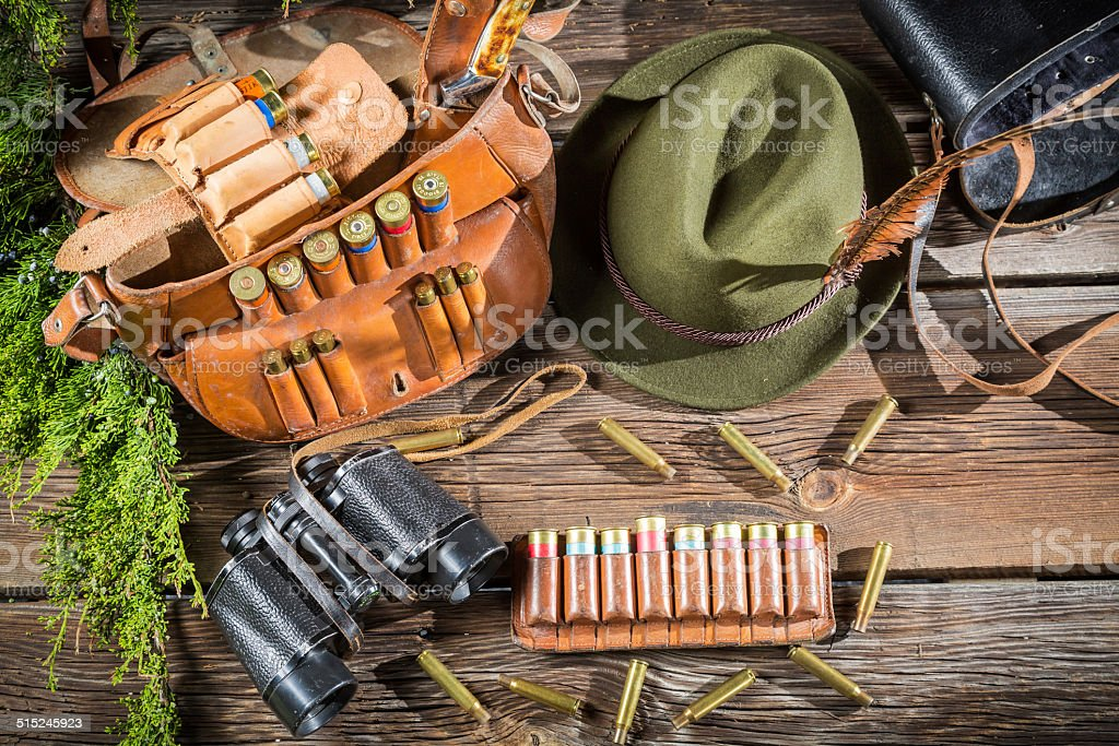 Preparing for the hunt in a forester cottage stock photo