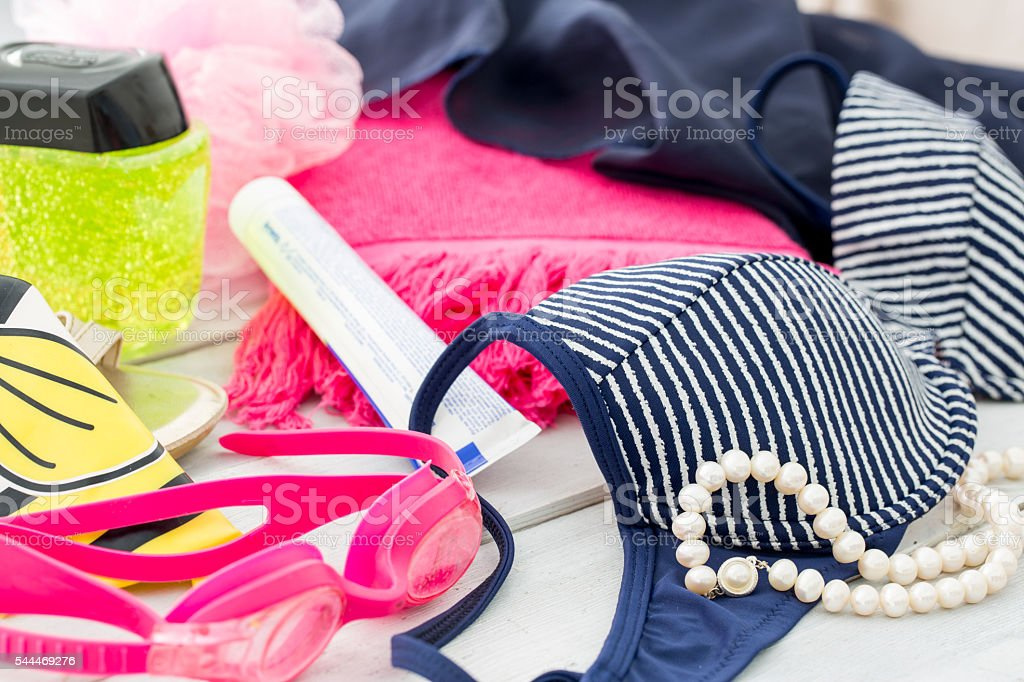Preparing for the vacation. Beach items, swimming suit and towel stock photo