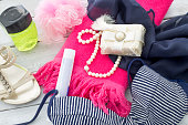Preparing for the vacation. Beach items, swimming suit and towel