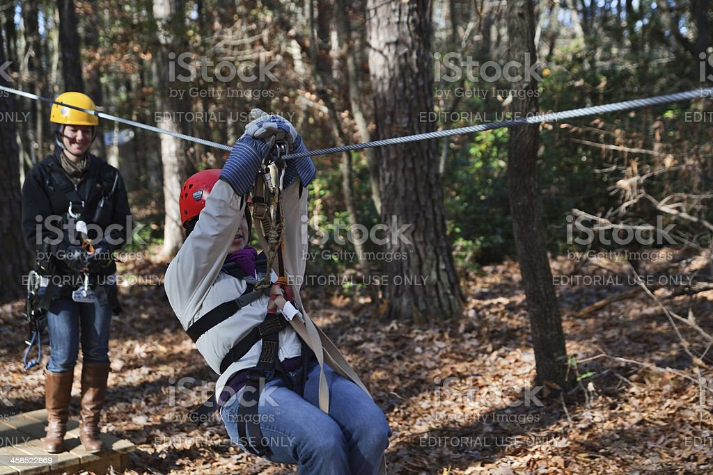 Preparing for zipline adventure stock photo