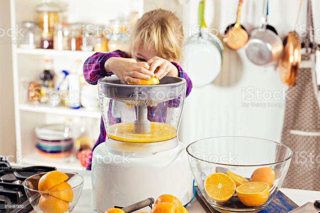 Preparing Fresh Homemade Orange Juice stock photo