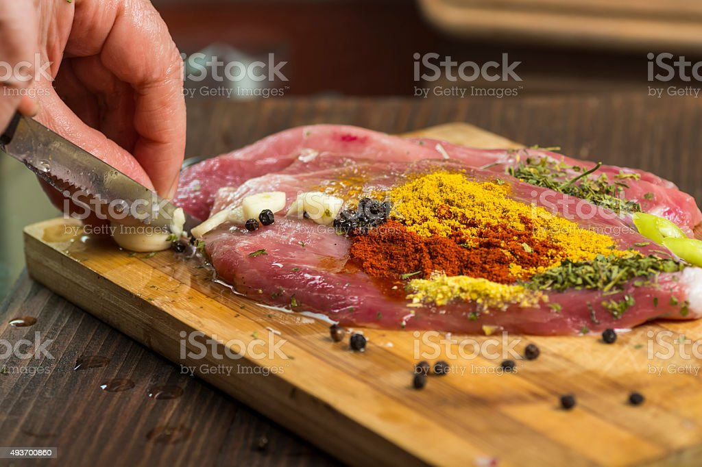 Preparing fresh meat for cooking royalty-free stock photo