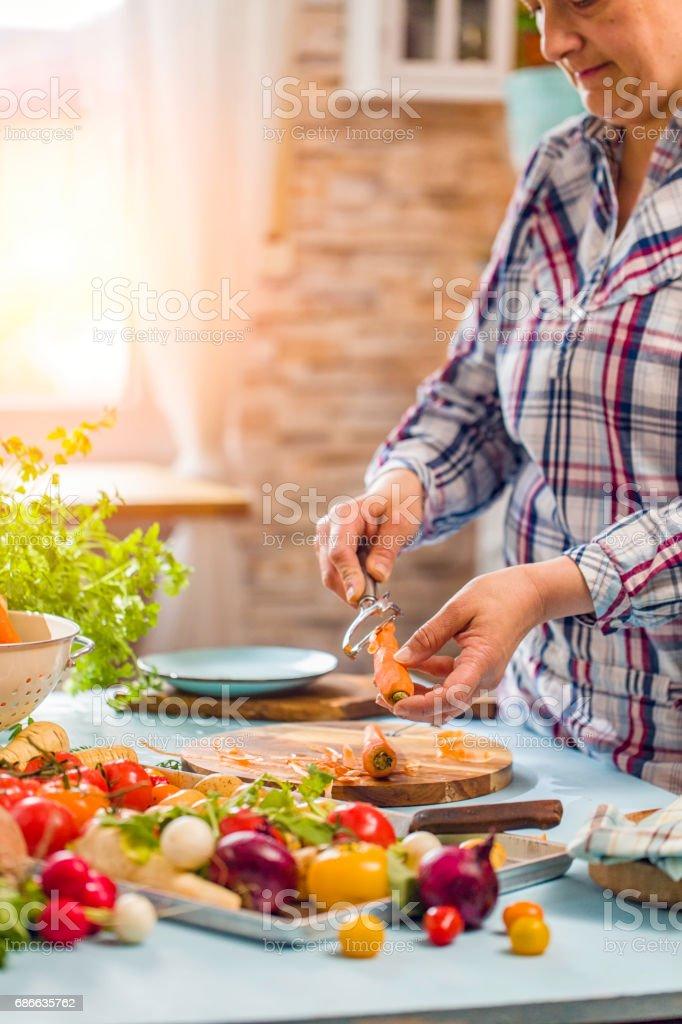 Preparing Fresh Summer Vegetables for Roasting stock photo
